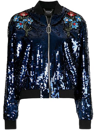 Comment choisir et porter une veste à sequins ? Ici blouson à sequins bleu brodé.